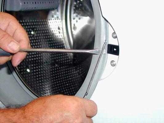 Снимаем манжету с передней стенки стиральной машины