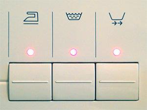 Кнопки дополнительных функций стирки стиральной машины